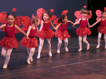 young dancers perform on stage